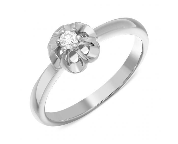 Каблучка з діамантом квіточка в білому золоті