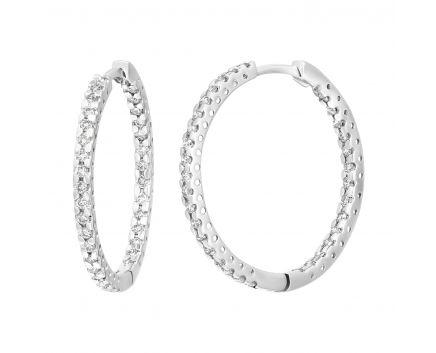 Сережки унікальність з діамантами в білому золоті