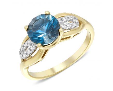 Каблучка з діамантами та синім топазом в жовтому золоті