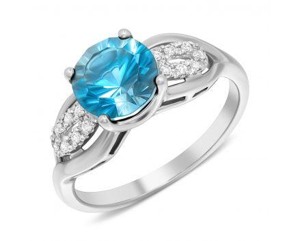 Каблучка з діамантами та блакитним топазом в білому золоті