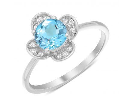 Каблучка квіточка з топазом та діамантами в білому золоті